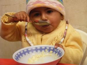 little one eats lunch