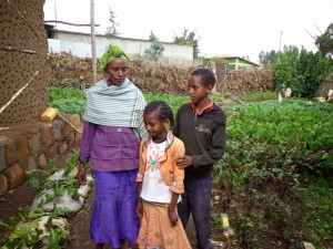 Asrat and her two youngest children. Her daughter is now a sponsored child through CFTC partner, ISAPSO.