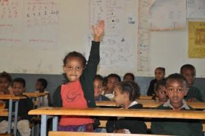 classroom - girl raises hand