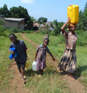 Catherine, her brother Michael, and their mother fetching water.
