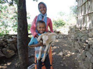 Truth About Goats: Two children proudly showcase their family goat.
