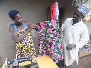 Tailor Made: a student proudly showcases a garment she made.