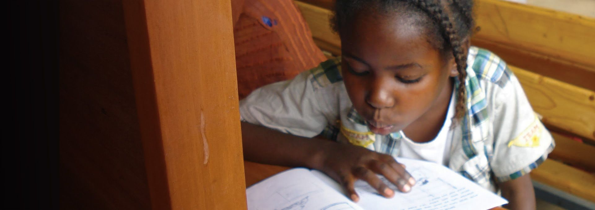 African girl reading